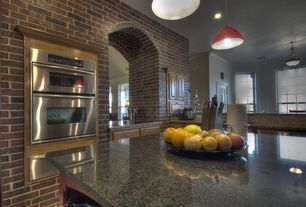 Modern Kitchen with L-shaped, Limestone Tile, Raised panel, Pendant light, Complex granite counters, double wall oven