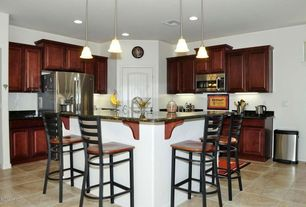 Traditional Kitchen with Ladder back bar stool, Kitchen island, Dark stained cabinets, Built In Refrigerator, Breakfast bar
