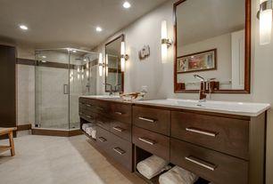 Contemporary Master Bathroom with frameless showerdoor, can lights, Rain shower, Vinyl floors, Corian counters, Double sink