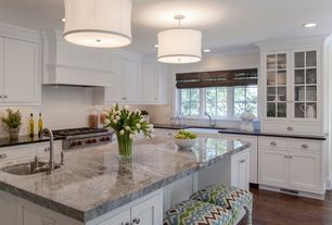 Traditional Kitchen with Hardwood floors, White kitchen cabinets, Glass front cabinets, Prep sink, Matchstick blinds