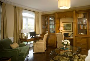 Traditional Home Office with Crown molding, Standard height, Arched window, flush light, Built-in bookshelf, Casement