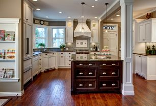Traditional Kitchen with Transom window, Crown molding, Flush, Columns, Undermount sink, Pendant light, Kitchen peninsula