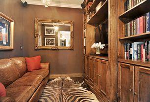Traditional Living Room with Hardwood floors, Built-in bookshelf, Crown molding, flush light