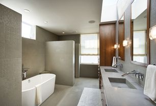 Contemporary Master Bathroom with Standard height, Casement, can lights, Flush, Wall sconce, Bathtub, Concrete counters