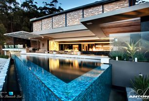 Contemporary Swimming Pool with Raised beds, Infinity pool, exterior stone floors, specialty window, Pathway, Fence