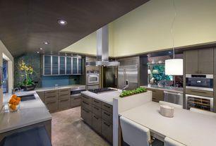 Modern Kitchen with Wine refrigerator, Kitchen island, High ceiling, Breakfast nook, U-shaped, Corian counters, Glass panel