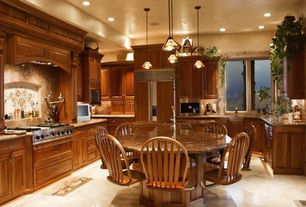 Traditional Kitchen with Raised panel, Custom hood, Kitchen island, Breakfast nook, Pendant light, Simple granite counters