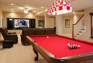 Traditional Basement with Ceiling fan, Built-in bookshelf, can lights, flush light, Spencer marston milano pool table, Carpet