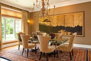 Traditional Dining Room with Crown molding, Wall sconce, Hardwood floors, Chandelier