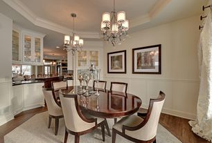 Traditional Dining Room with Hardwood floors, Crown molding, Wainscotting, High ceiling, Chandelier
