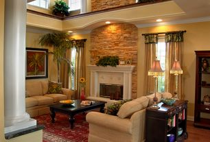 Traditional Living Room with double-hung window, Crown molding, Columns, Clara Black Coffee Table, Fireplace, can lights