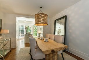 Contemporary Dining Room with Natural wood dining table, Cordele chrome and glass sofa table, flush light, Hardwood floors