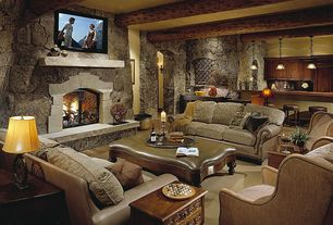 Rustic Basement with Standard height, Pendant light, Exposed beam, Hardwood floors, Wall sconce, stone fireplace, Fireplace