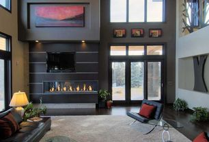 Modern Living Room with Hardwood floors, Cathedral ceiling, Transom window