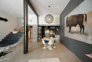 Modern Dining Room with Concrete floors, Pendant light, Columns