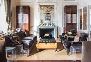 Traditional Living Room with Built-in bookshelf, High ceiling, Cement fireplace, Glass panel door, Chair rail