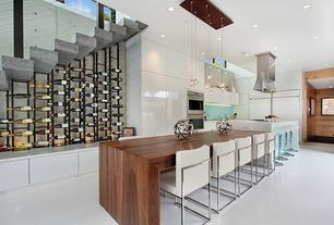 Contemporary Kitchen with Pendant light, European Cabinets, Breakfast bar, Island Hood, High ceiling, double wall oven, Flush
