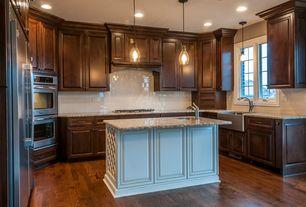 Traditional Kitchen with Subway Tile, electric cooktop, Hardwood floors, Kitchen island, Flat panel cabinets, Pendant light