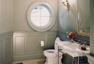 Traditional Powder Room with Wainscotting, specialty window, Paint 1, Console sink, Wall sconce, Powder room, Standard height