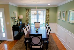 Traditional Dining Room with Jemima Console Table, Wainscotting, Hardwood floors, Pendant light, Windward Bay Side Chair