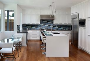 Contemporary Kitchen with Breakfast bar, Soapstone counters, Corian- Designer White, Waterfall countertop, full backsplash