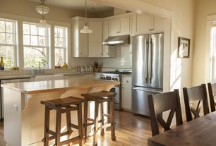 Craftsman Kitchen with Subway Tile, flush light, dishwasher, Pendant light, Breakfast bar, Farmhouse sink, Wall Hood, Paint