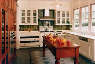 Craftsman Kitchen with gas range, Wainscotting, Wall Hood, Inset cabinets, Flat panel cabinets, Wood counters, Glass panel