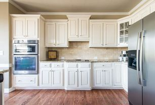 Traditional Kitchen with Granite countertop, Paint 1, Standard height, electric cooktop, Travertine subway tile, L-shaped