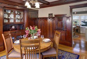 Craftsman Dining Room with Chandelier, Hardwood floors, Crown molding, specialty door, Box ceiling, Built-in bookshelf