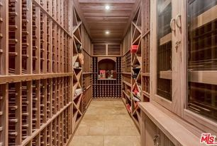 Traditional Wine Cellar with Built-in bookshelf, sandstone tile floors