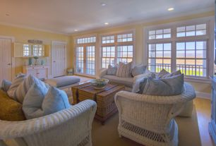 Cottage Living Room with Transom window, six panel door, double-hung window, picture window, Standard height, Crown molding