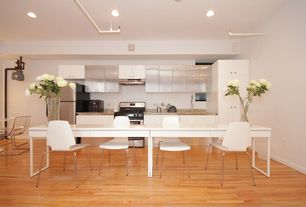 Contemporary Kitchen with Corian counters, Undermount sink, Flush, Flower 48 in. Table, VILMAR Chair, white, chrome plated