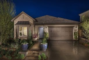 Traditional Exterior of Home with exterior tile floors, Fence, Pathway