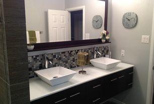 Contemporary Master Bathroom with Corian counters, Daltile Coastal Keystones Treasure Island Mosaic Tile, Vessel sink, Flush