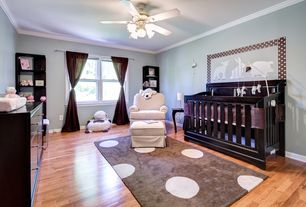 Contemporary Kids Bedroom with Nursery, Brown irregular polka dot 3'x5' area rug, Ceiling fan, Laminate floors, Mural