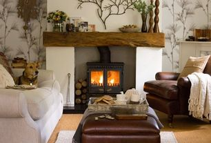Eclectic Living Room with Cement fireplace, Arteriors Edwin Metal Tree Branch Wall Sculpture, Throw blanket, Sofa, Carpet