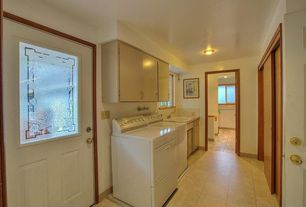 Craftsman Laundry Room with Built-in bookshelf, Glass panel door, limestone tile floors