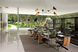 Contemporary Dining Room with Laminate floors, Pendant light, Frameless windows