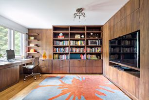 Modern Home Office with Casement, Standard height, Hardwood floors, Chandelier, Built-in bookshelf