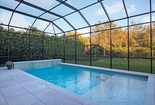 Contemporary Swimming Pool with Pool Cages, Fountain, exterior tile floors, Skylight, Fence, exterior stone floors, Lap pool