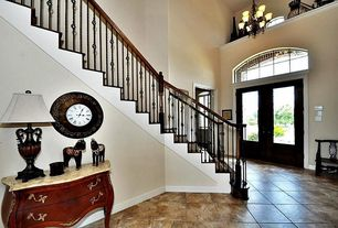 "Traditional Entryway with travertine tile floors, High ceiling, Yosemite home decor 17"" wall clock, French doors, Chandelier"