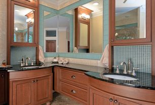 Traditional Master Bathroom with Ceramic Tile, Flush, Arched window, Soapstone counters, Flat panel cabinets, Crown molding
