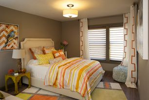 Modern Guest Bedroom with specialty window, Hardwood floors, Standard height, flush light