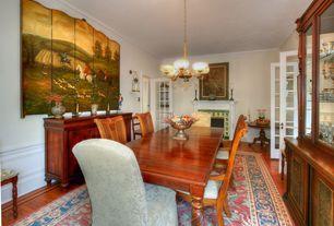 Traditional Dining Room with French doors, Wainscotting, Crown molding, Glass panel door, Chandelier, Hardwood floors