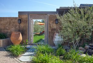 Mediterranean Landscape/Yard with Pond, exterior stone floors, Fence, Arbor, Pathway, Trellis, Wall mounted lantern