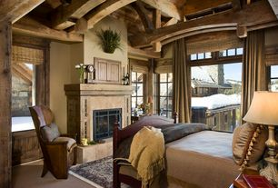 Rustic Guest Bedroom with Carpet, French doors, Eldorado Stone The Carmela in Oak Barrel with Honed finish., Exposed beam