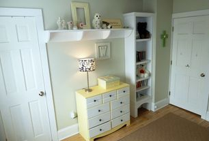 Traditional Kids Bedroom with Hardwood floors, Built-in bookshelf