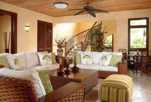 Tropical Living Room with Rowe Furniture Martin Ottoman, sandstone tile floors, Ceiling fan, Standard height, Crown molding