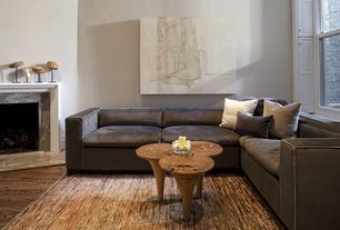 Contemporary Living Room with Cement fireplace, Hardwood floors