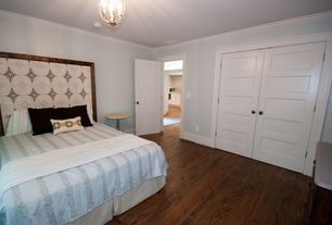 Cottage Master Bedroom with Hardwood floors, Chandelier, Crown molding, Built-in bookshelf, specialty door, Standard height
